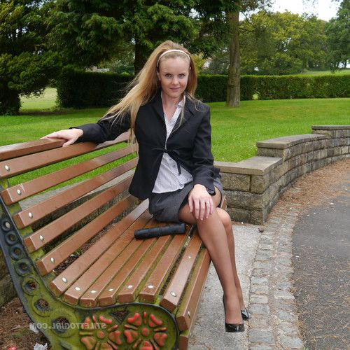 Cute blonde is outdoors in tall black high heel shoes and sexy n