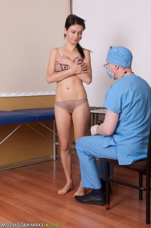Male gynecologist examines a smalltitted patient