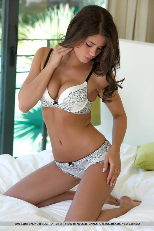 European lingerie model Caprice A undresses to pose for glamour spread
