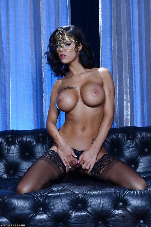 Pornstar wife Peta Jensen strutting in mask and stockings for babe photos