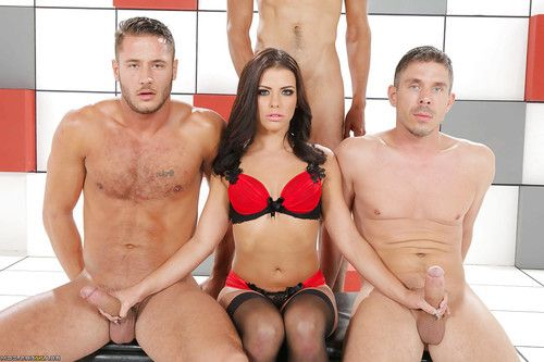 Hot brunette Adriana Chechik is holding two dicks simultaneously