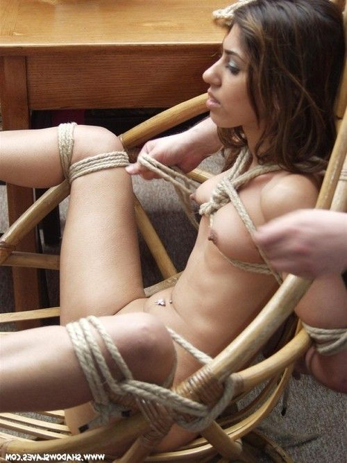 Amateur indian beauty is tied to a wicker chair using strict rop
