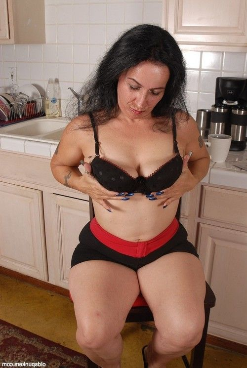 Granny Nina demonstrates her sweet big boobies in the kitchen