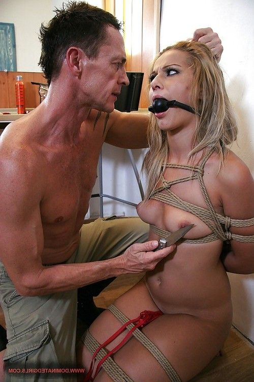 Blonde babe fucking with a gag in her mouth in a dirty BDSM action