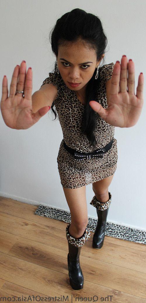 Asian mistress tramples slave