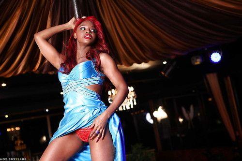 Redhead ebony pornstar Jasmine Webb performing a hot striptease