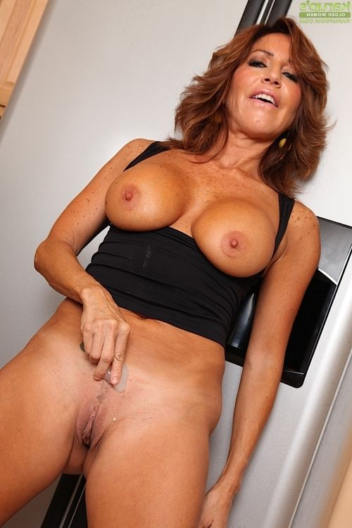 Aged Latina Tara Holiday stripping nude in kitchen for masturbation session