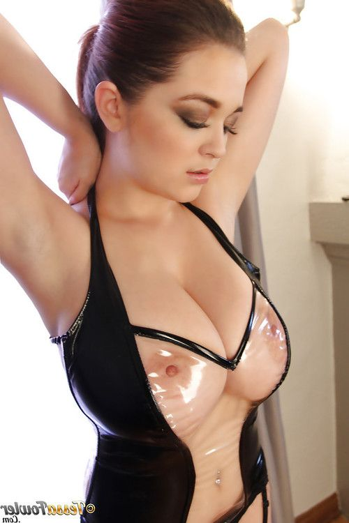 Big-tit brunette Tessa Fowler poses in a hot latex corset in close-up