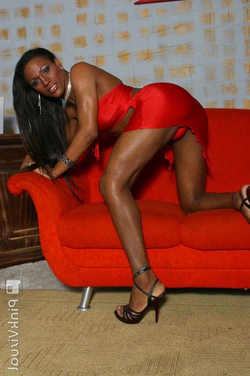 Busty ebony tranny Anarah having her big black cock sucked by stud