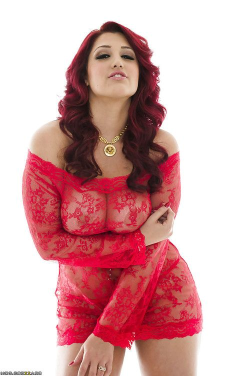 Redhead babe Dayna Vendetta showcasing her tempting curvaceous body