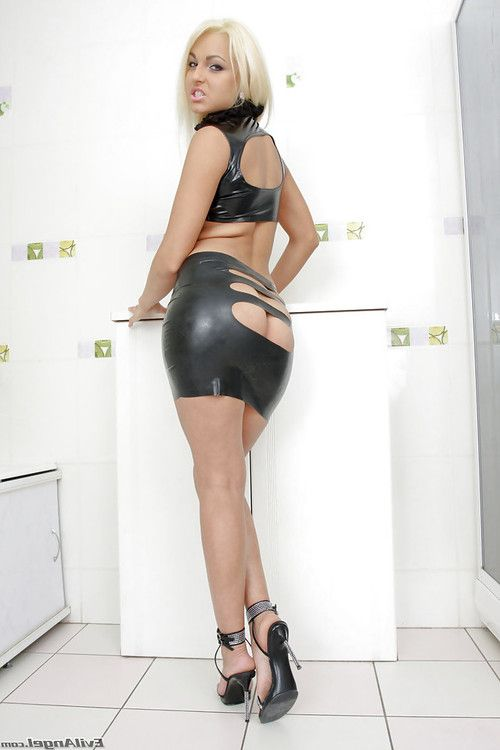 Sexy blonde in latex dress exposing her petite ass and sweet love holes