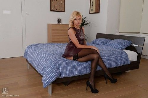 Skinny blonde Lana Roberts is taking off her tight leather dress
