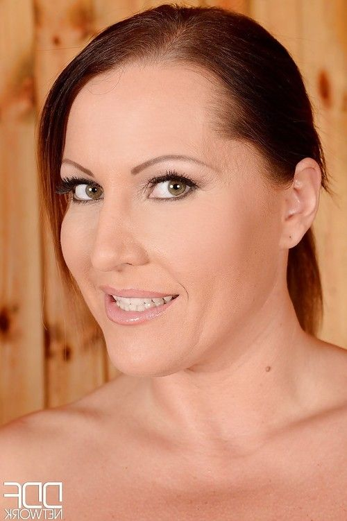 European milf with really big tits Laura Orsolya frolics in the sauna