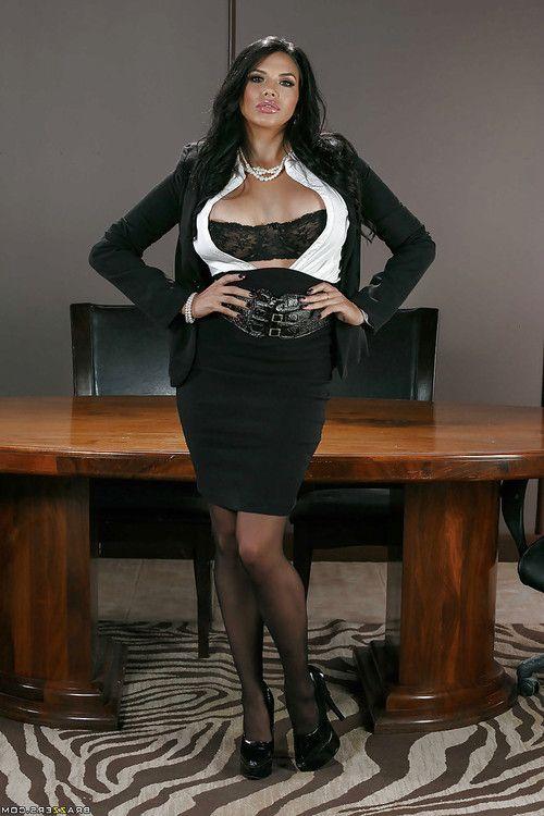Buxom brunette boss lady Missy Martinez strips down to sexy lingerie