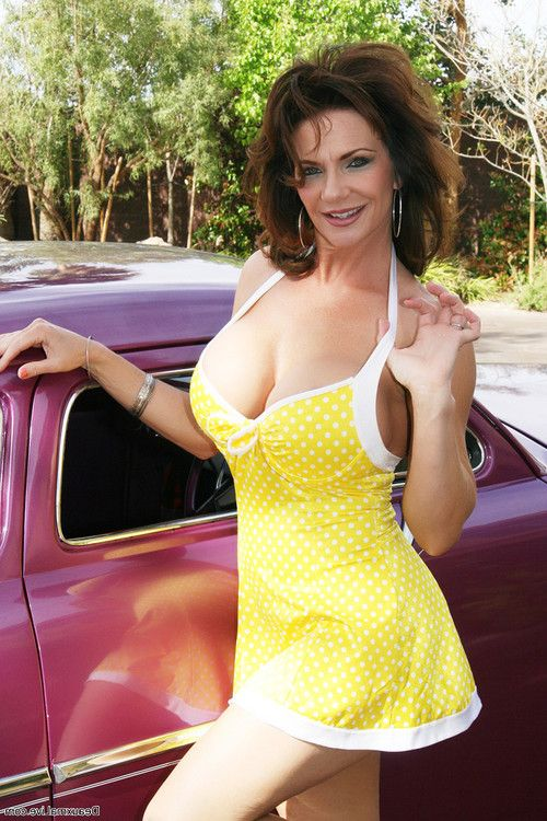 Sexy milf deauxma shows off by a car