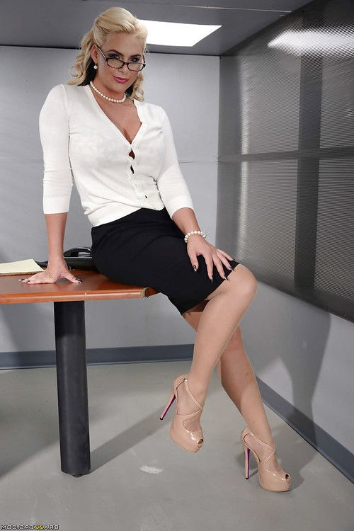 Hot blonde secretary in glasses and black skirt strips naked