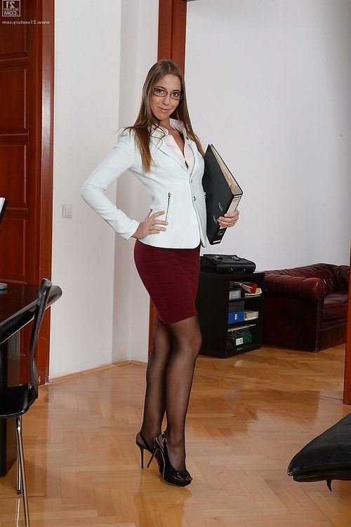 Hot office chick Suzie Moss is a sexy babe in skirt and pantyhose