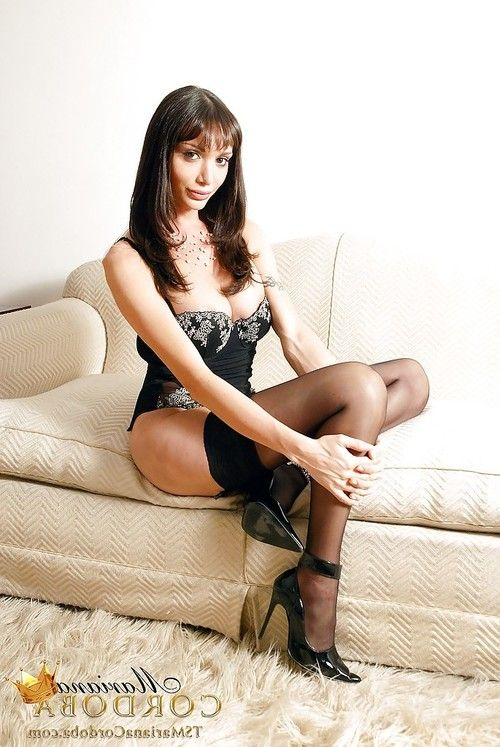 Gorgeous shemale Mariana Cordoba posing solo in stockings and high heels
