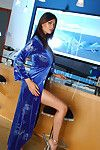 Sexy Asian MILF pornstar Tera Patrick flaunts hot body fully clothed