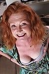 Mature redhead girl with big boobs Veronica spreading her tight pussy