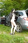 Salacious brunette babe revealing her tempting curves outdoor