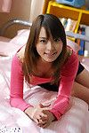 Pretty asian teen babe in socks uncovering her petite body