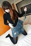 Asian teen Manami Igawa undressing and demonstrating her juicy slit
