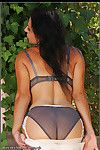 Sexy milf wearing grey seamed stockings and showing off