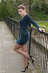 Hot babe naomi outdoors in short dress showing off sexy long nyl