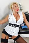 Busty secretary Michelle Thorne showing her ass in sexy stockings