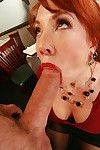 Busty milf redhead takes a huge cock on the job
