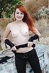 Redhead punk chick Nicci Vice showing off natural tits in forest