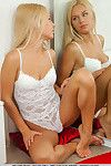 Blonde Euro babe shedding lingerie to expose phat teen ass for glam photos
