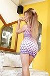 Beautiful teen shemale Raissa Angel posing seductively in mini skirt