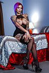 Tattooed babe Anna Bell Peaks flaunting large boobs in stockings and heels