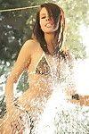 Destiny moody in a tiny bikini outdoors spraying her body with hose