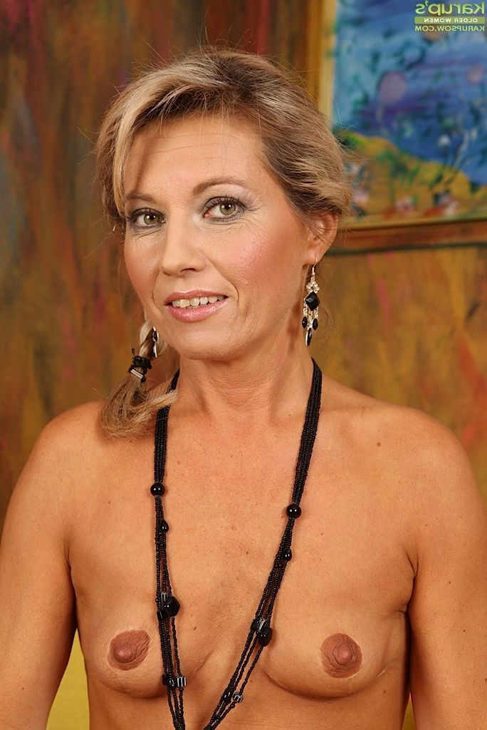 older blond in pigtails strips naked to masturbate her