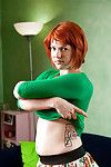 Redhead amateur model Jette poses her hairy muff in the nude