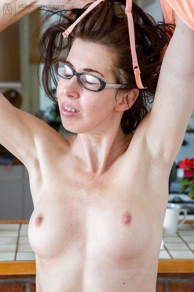 Mature nerd Bonnie C flashing curly upskirt muff for close ups