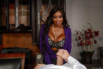 Buxom ebony MILF Diamond Jackson taking cumshot after office handjob