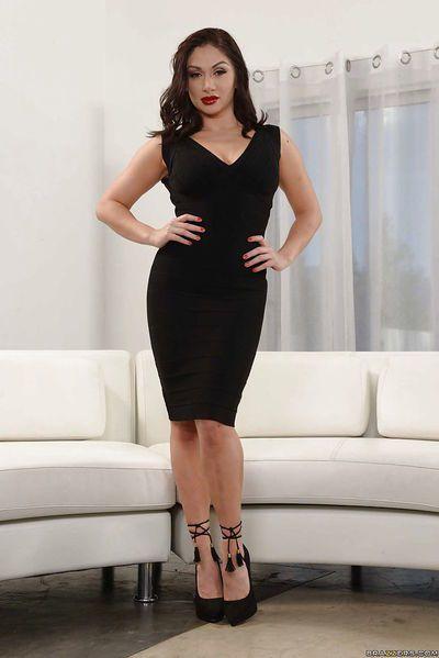 Brunette solo model Lea Lexis removing black dress to model in underthings