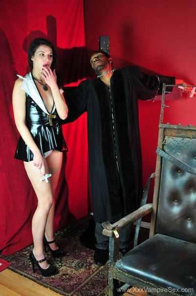 Sexy female vampire biting horny black priest during masturbation