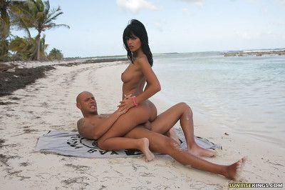 Luscious pornstar Black Angelika enjoys hardcore anal on the beach