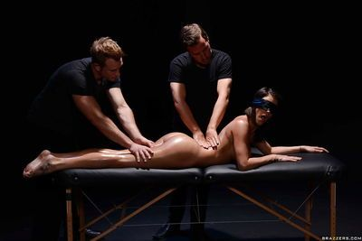 Blindfolded pornstar Peta Jensen is massaged by two men before DP