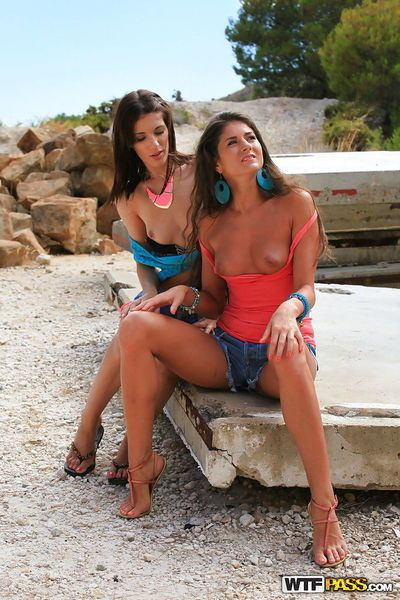 Nasty lesbian couple Nessa and Carol getting intimate on the beach