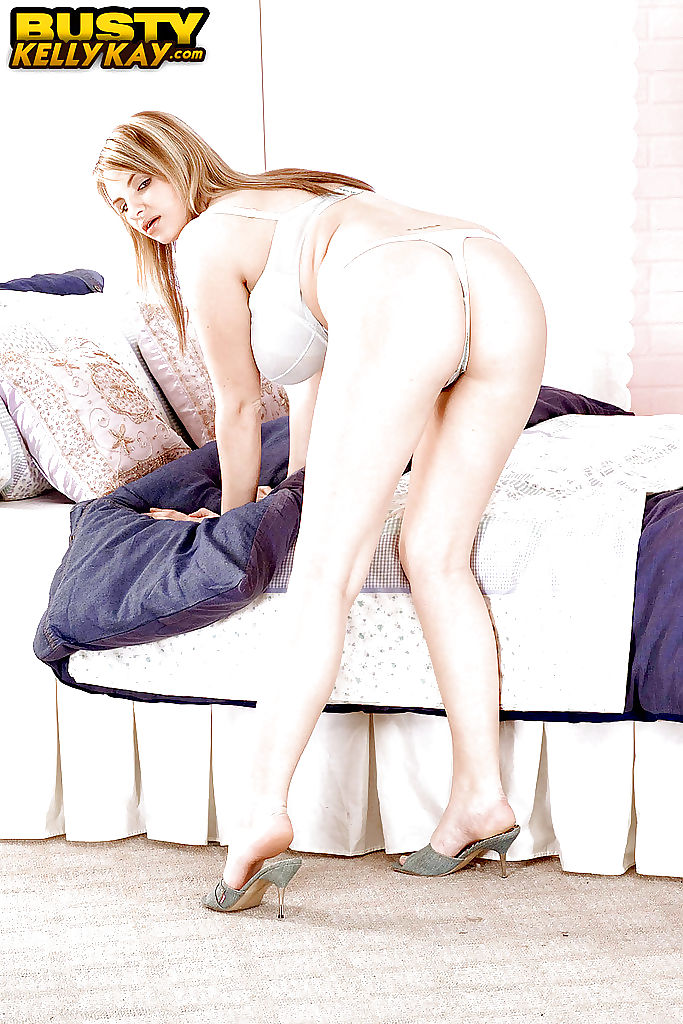 Busty blonde babe Kelly Kay fondling huge saggy pornstar tits and nipples
