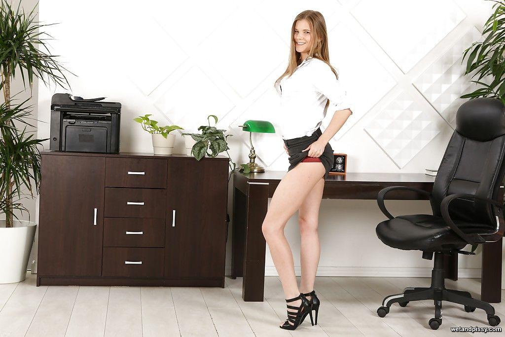 Leggy secretary Sarah Key pissing on short skirt and licking it up