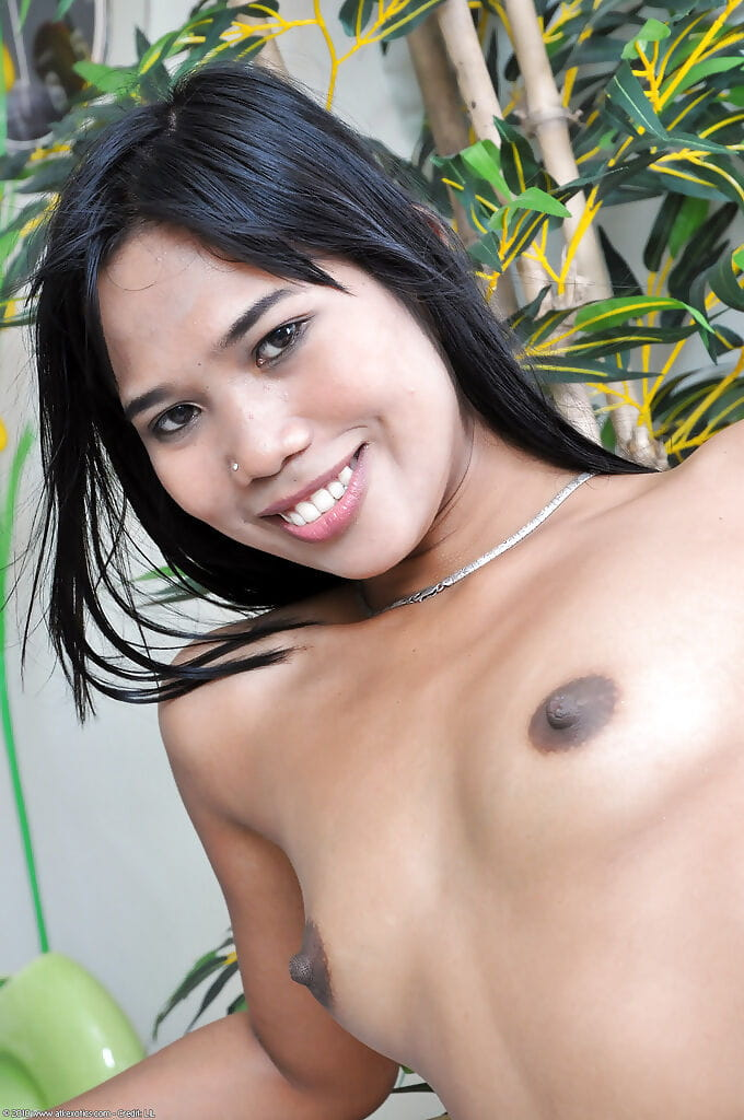 Innocent-looking Asian Anne is playing with her hard nipples