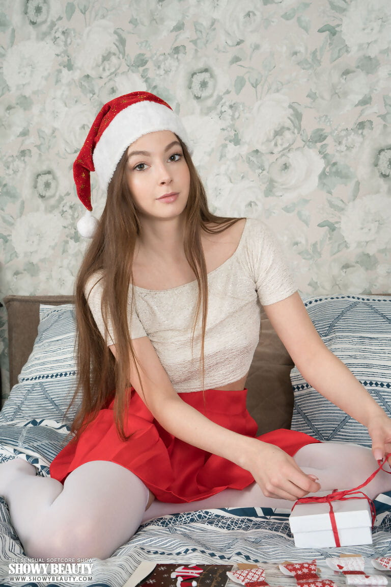 Cute teen Angela showcases her tight slit after doffing Xmas themed clothing