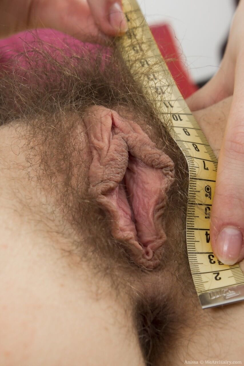 Young first timer with black hair wears a smile while unveiling her hairy bush